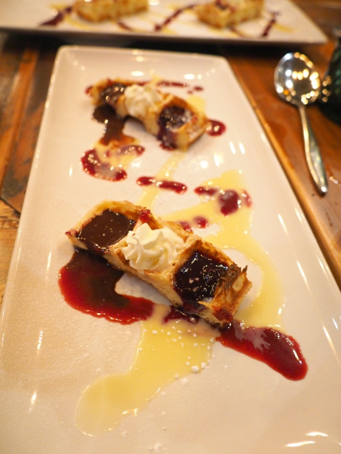 Belgian waffles with chocolate whipped cream and berry jam at Belgo restaurant London