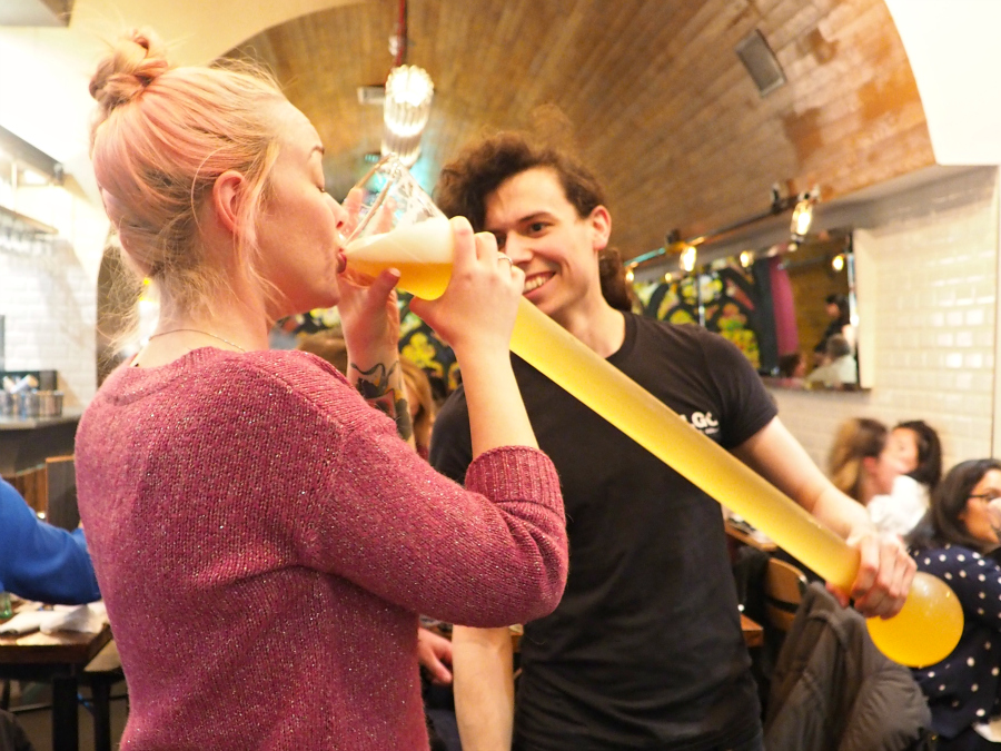 Food blogger drinking a yard of Belgian beer at Belgo London