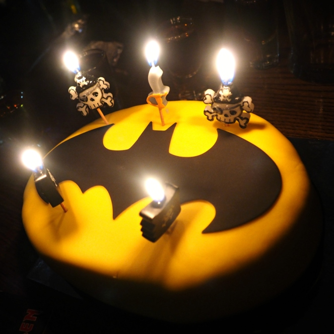 batman birthday cake with pirate skull candles