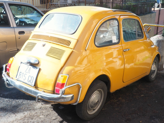 Cute Vintage Yellow Beetle Car in Rome Italy, Travel Blogger