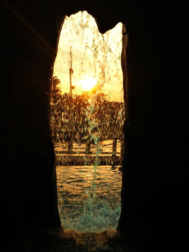 Moby Dick Mini Crazy Golf Sunset through Waterfall